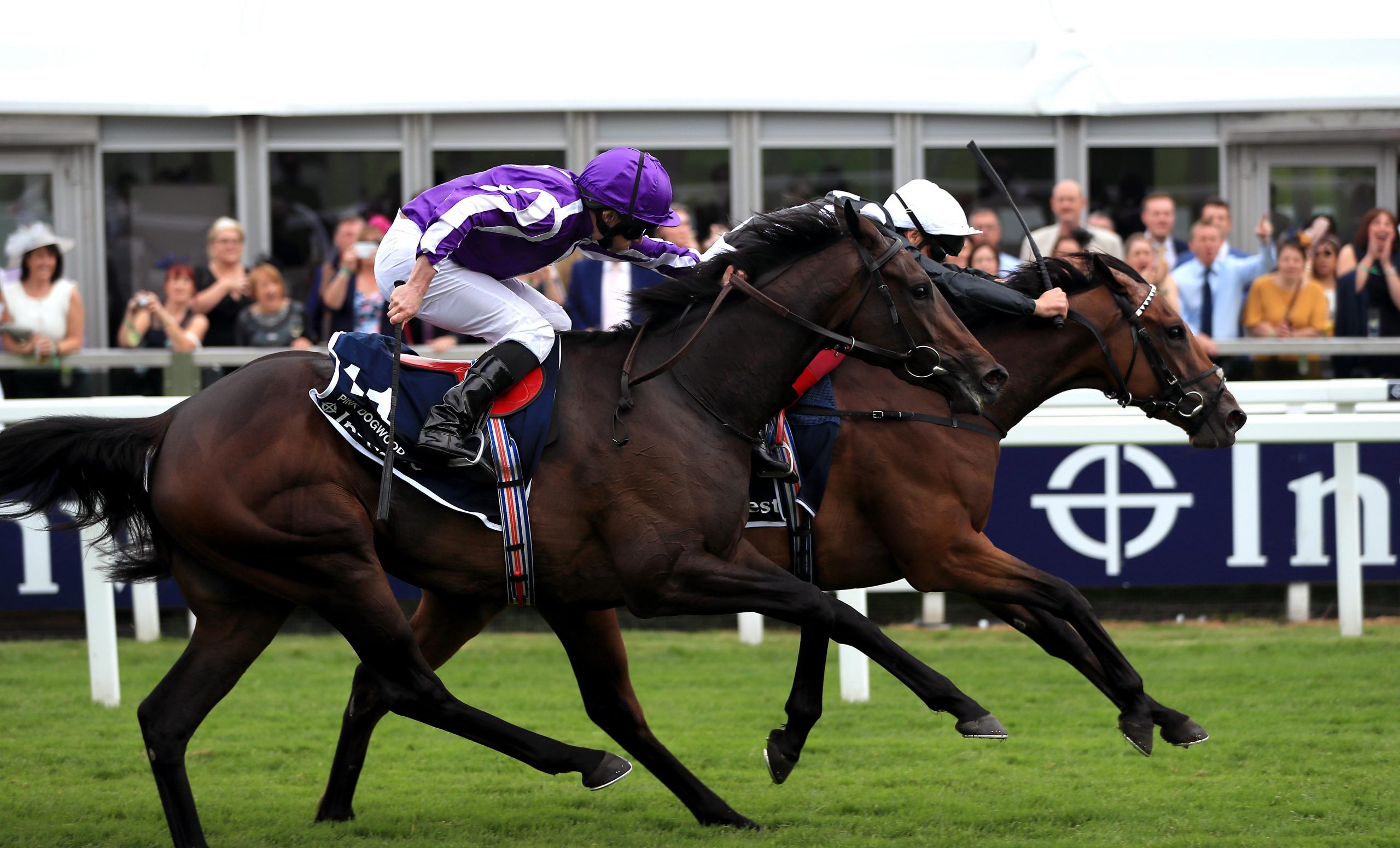 Anapurna ridden by Jockey Frankie Dettori (right) on the way to winning the Investec Oaks during Ladies Day of the 2019 Investec Derby Festival at Epsom Racecourse, Epsom.