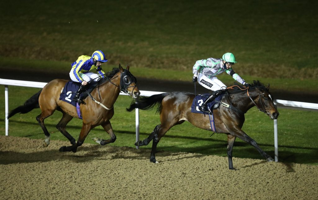 Classical Wave ridden by Daniel Muscutt (right) coming home to win the Play 4 To Win At Betway Handicap ahead of Starfighter ridden by Richard Kingscote at Wolverhampton racecourse. Picture date: Monday February 22, 2021.