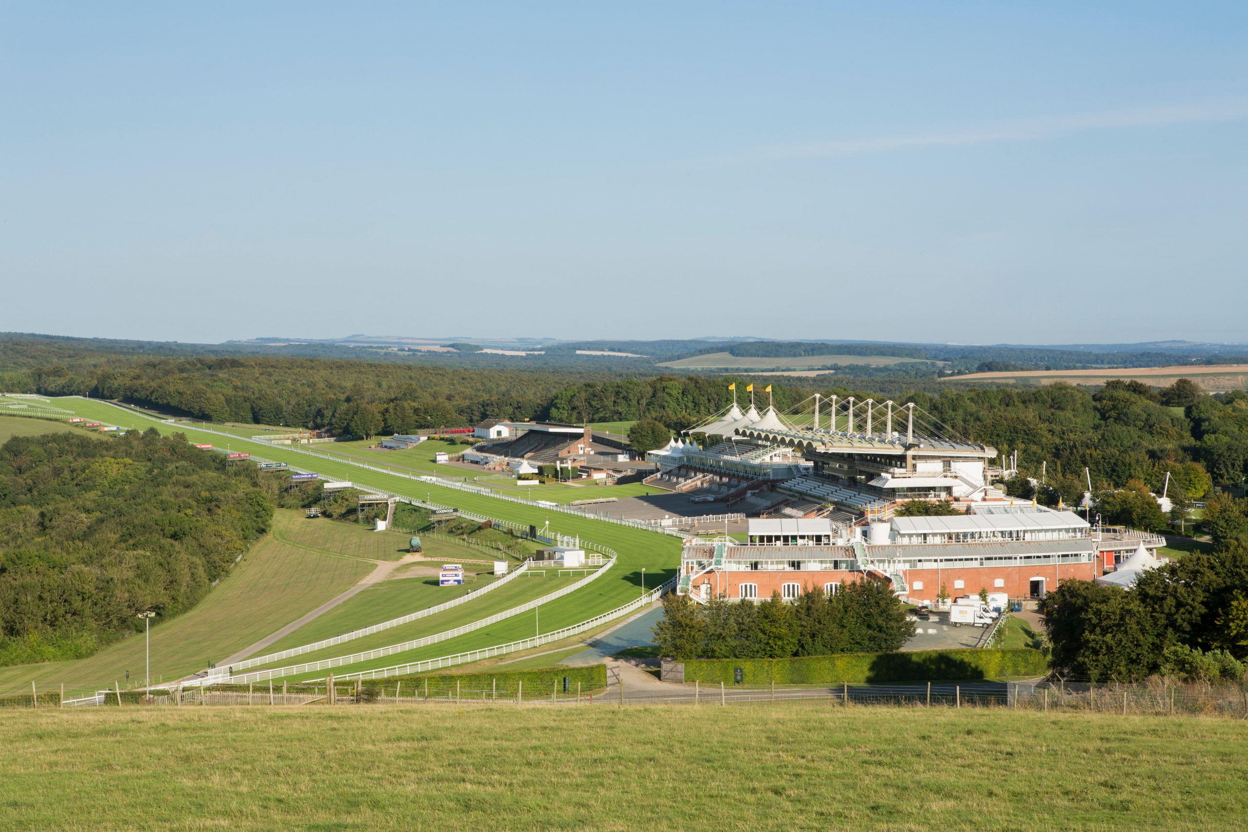 Goodwood racecourse in the South Downs West Sussex. View of the empty grandstands on a summers day.