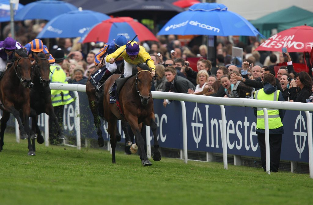 Sea The Stars ridden by jockey Mick Kinane goes on to win the Investec Derby during Derby Day at Epsom Downs Racecourse