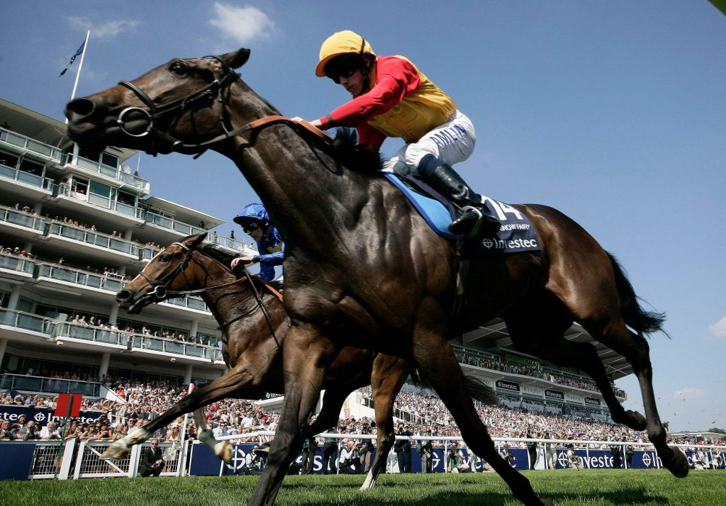 Horse Racing - Epsom Derby Meeting - Epsom Downs - 4/6/10 Snow Fairy ridden by Ryan Moore wins the 4.05 The Investec Oaks Mandatory Credit: Action Images / Paul Harding Livepic