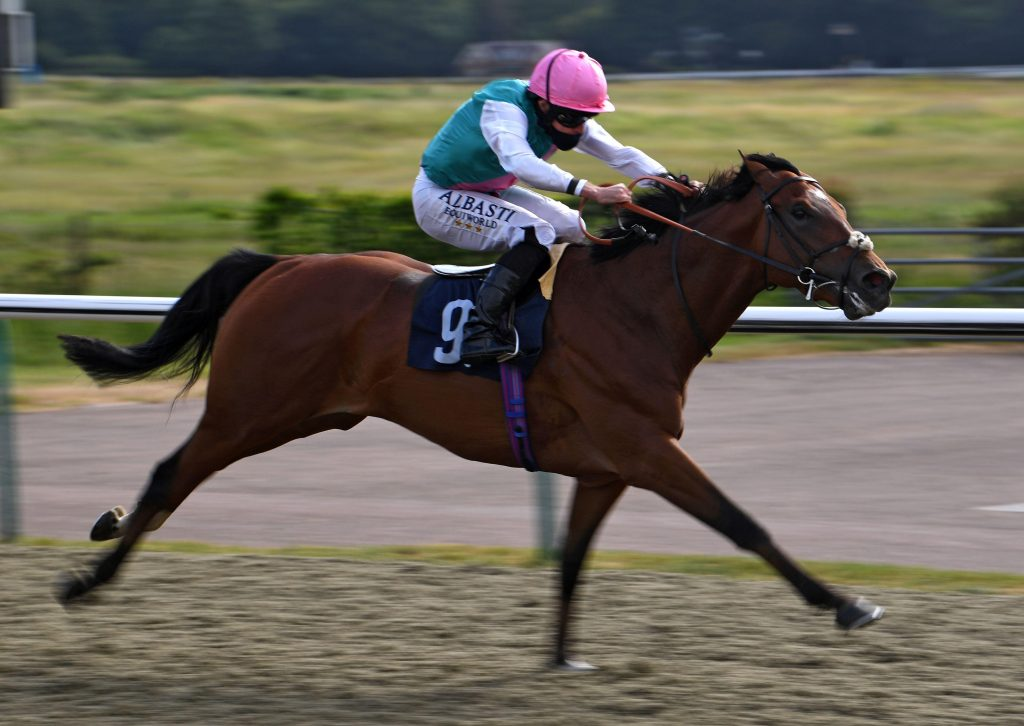 2BXT5B9 Ransom ridden by Ryan Moore wins the Betway Maiden Stakes at Lingfield Racecourse.