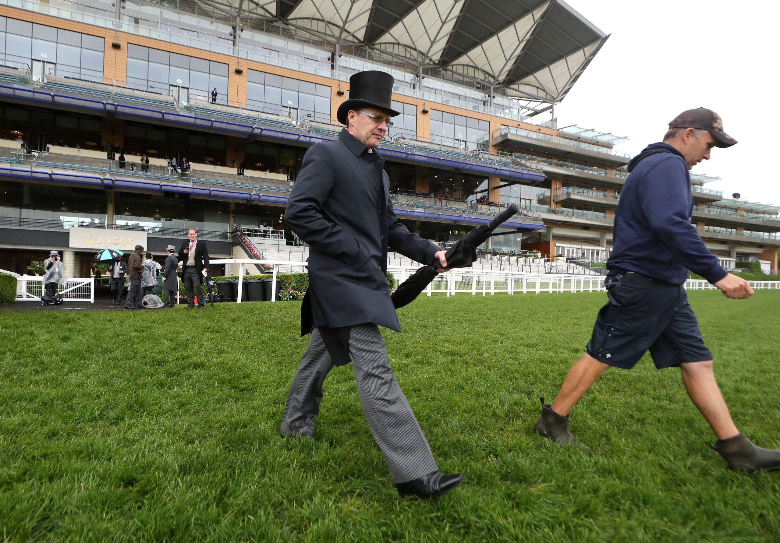 2G3Y8G3 Trainer Aidan O'Brien walks out to check the ground during day four of Royal Ascot at Ascot Racecourse. Picture date: Friday June 18, 2021.