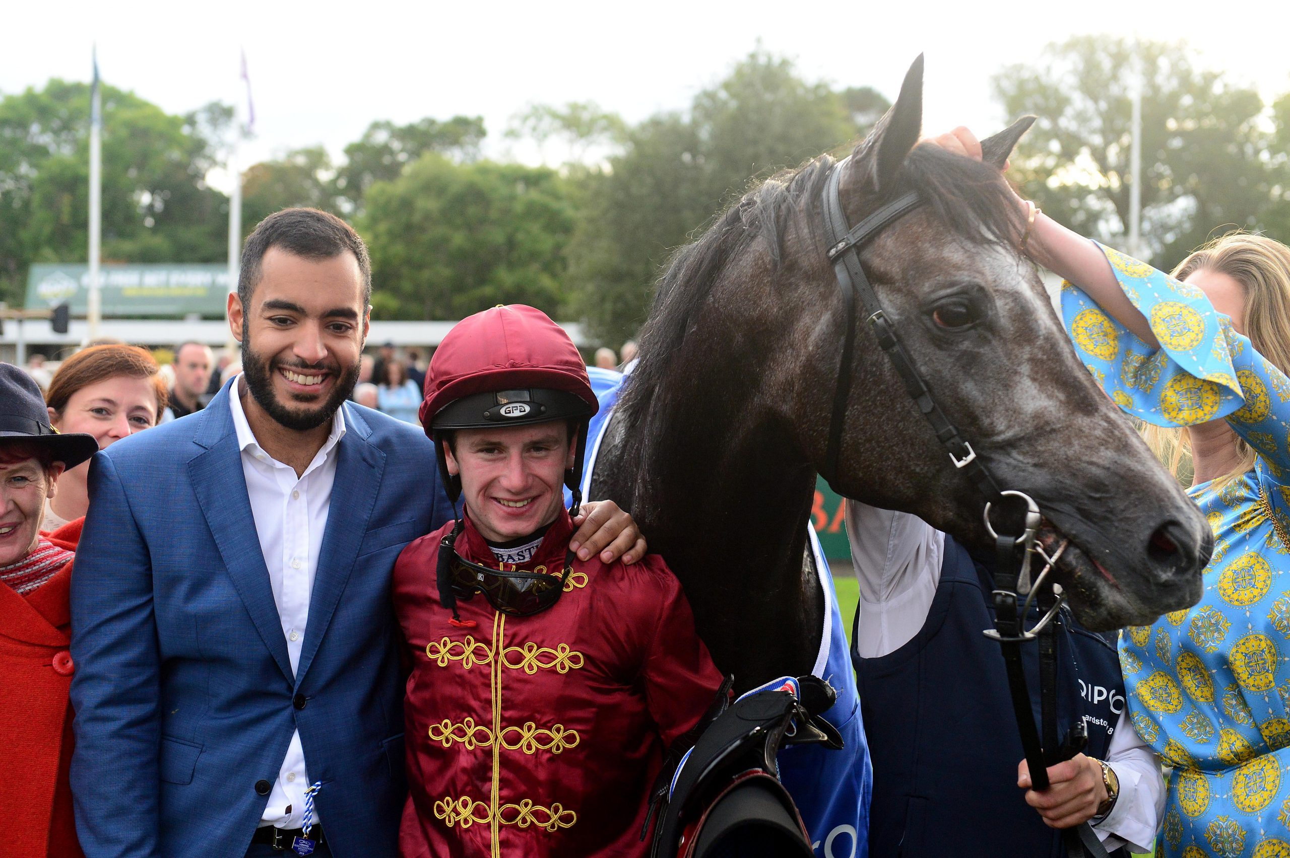 PKW6EM Horse Roaring Lion and owner Sheikh Fahad Al Tani and jockey Oisin Murphy (centre) after win during day one of the 2018 Longines Irish Champions Weekend at Leopardstown Racecourse, Dublin.