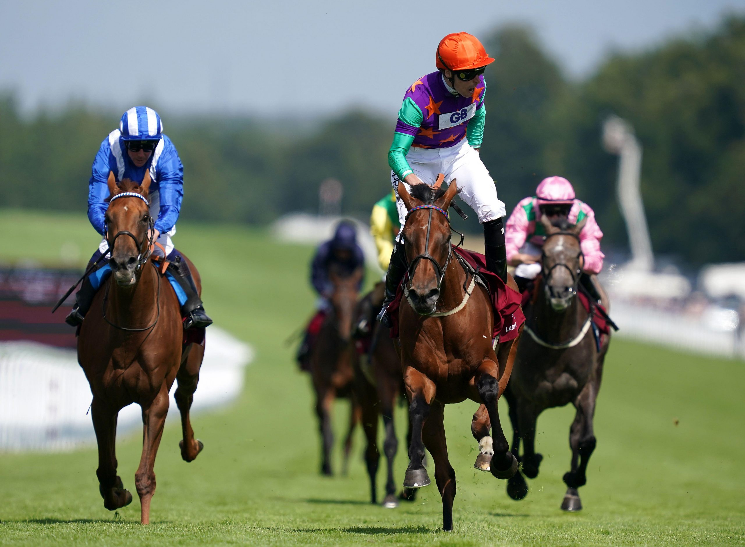 2GA7P0J Lady Bowthorpe ridden by jockey Kieran Shoemark (right) wins the Qatar Nassau Stakes (Fillies' Group 1) (British Champions Series) during day three of the Goodwood Festival at Goodwood Racecourse, Chichester.